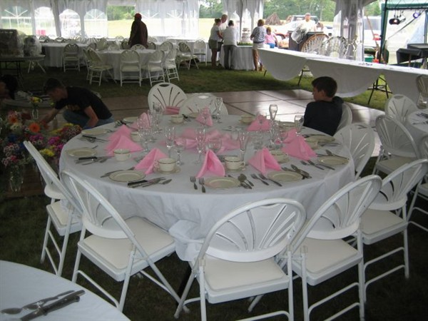 Seen In Photo: 120 White Tablecloth / 72 Round Table / White Padded Chairs /